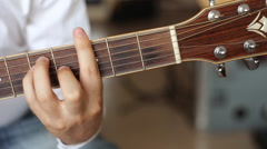 Hands playing acoustic guitar, dolly shoot Stock Footage