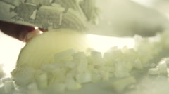 Close in High speed of onion being chopped - stock footage