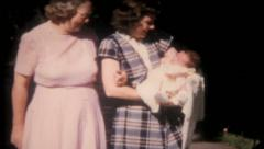 2175 - proud mother shows her newborn to the camera - vintage film home movie Stock Footage