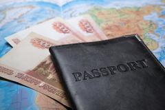 passport in the bag on a map with bank notes - stock photo