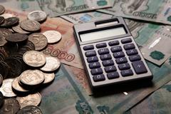 Handful of Russian rubles with calculator Stock Photos