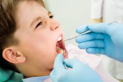 Inspection of oral cavity - stock photo