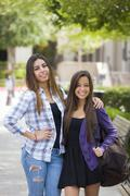 Mixed Race Female Students Carrying Backpacks on School Campus Stock Photos