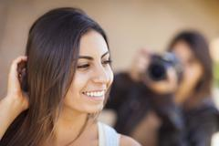 Young Adult Mixed Race Female Model Poses for Photographer - stock photo