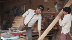 Man and boy working in a sawmill, child labor India, medium shot Stock Footage