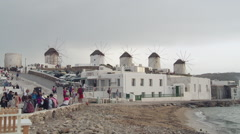 Windmills and Tourists on Mykonos Zoom In Stock Footage