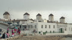 Windmills and Tourists on Mykonos Zoom Out - stock footage
