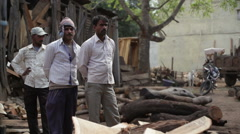 Simple Indian farmers at a sawmill, medium shot, shallow DOF Stock Footage