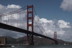 Low angle view of Golden Gate Bridge over river against cloudy sky Kuvituskuvat