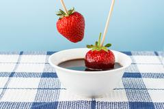 strawberries with chocolate topping - stock photo