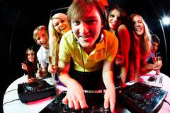 Deejay and friends - stock photo