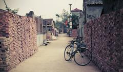 Bicycle parked narrow street in Hanoi, Vietnam Stock Photos