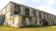 Abandoned WWII hangar, wide shot Stock Footage