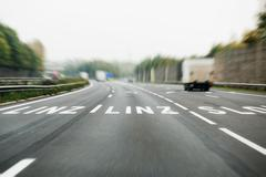 German autobahn with roadmarking sign to Linz, Austria - stock photo