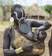 Stock Photo of Woman from Mursi tribe in Mirobey village.