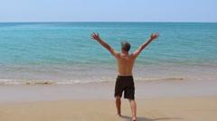 Elderly man enjoying out to sea Stock Footage