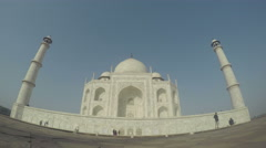 Front facade of Taj Mahal with people passing, time lapse. Stock Footage