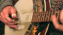 Man playing the banjo in a band Stock Footage