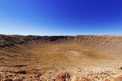 Meteor Crater against clear blue sky - stock photo