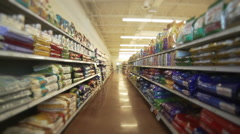 Moving down store aisle Stock Footage