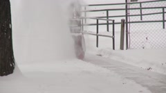Snow-blower snow sweeper in action, medium shot head on Stock Footage