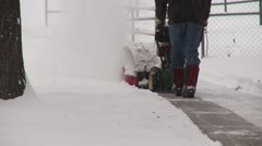 Snow-blower snow sweeper in action, medium shot Stock Footage