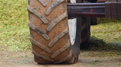 Tractor wheel during the preparation of silage corn for winter: livestock feed Stock Footage