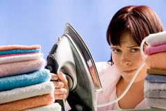 Reluctant to iron - stock photo