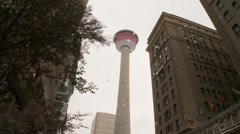 Two men rappel off Calgary Tower, nice zoom in Stock Footage