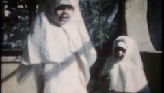2190 - little girls play dress up like nuns - vintage film home movie Stock Footage