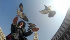 SLO MO Shot Woman feeding pigeons on St. Mark's Square. HD stock footage - stock footage