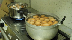 Eggs boiled in a pot Stock Footage