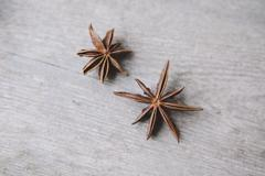 High angle view of star anise on wooden table Stock Photos