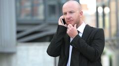 Businessman using smartphone: businessman having phone call, conversation Stock Footage