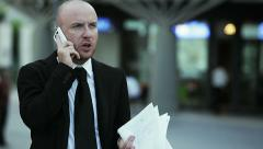 businessman at work with smartphone - stock footage