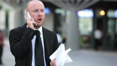 Businessman having an important phone call: mobile phone, smartphone Stock Footage