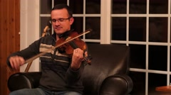 Man playing violin in family band Stock Footage