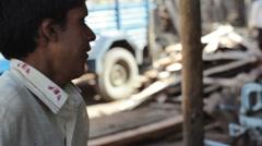 Man sawing timber, medium shot, shallow DOF Stock Footage