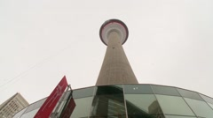 Two men rappel off Calgary Tower zoom in to top Stock Footage