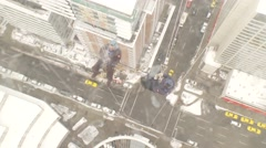 Two men rappel off Calgary Tower from above, traffic below Stock Footage