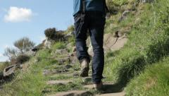 Hiker climbing a path in Northumberland Stock Footage