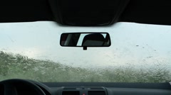 Stock Video Footage of Rain splatters car windshield during severe storm, windscreen wipers cleaning wi