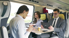 Busy businesspeople working in the train, steadycam shot Stock Footage