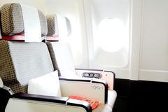 Commercial passengers airplane interior Stock Photos