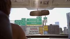 U-Haul truck driving signs Brooklyn Bridge female car rearview mirror 4K NYC Stock Footage