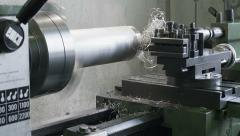Old lathe at work on an aluminum cylinder Stock Footage
