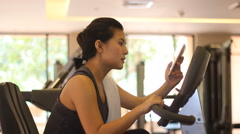 Fit woman and  smart phone in the fitness club Stock Footage