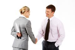 Dangerous handshake Stock Photos