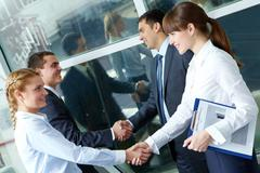Parallel handshakes Stock Photos
