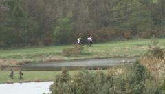Three racehorses gallop during race. Stock Footage